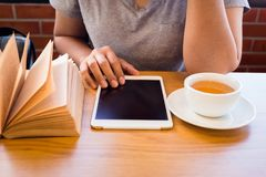 Tea Break with Tablet and Book Royalty Free Stock Photo