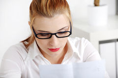 Closeup on woman reading files. Stock Image