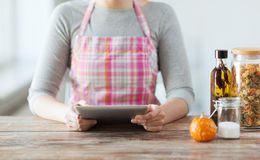 Closeup of woman reading recipe from tablet pc Stock Image