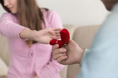 Closeup of woman rejecting, refusing marriage proposal, engageme Stock Image