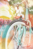 Closeup of woman riding by blue vintage city bicycle Stock Image
