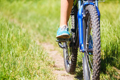 Closeup  woman riding mountain bike Royalty Free Stock Image