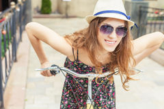 Closeup woman riding by vintage city bicycle at city center Stock Image