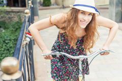 Closeup woman riding by vintage city bicycle at city center Royalty Free Stock Photo