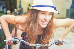 Closeup woman riding by vintage city bicycle at city center Royalty Free Stock Photography