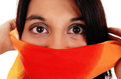 Closeup of woman`s eyes, mouth covered. Royalty Free Stock Images