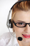 Closeup on woman`s face with headset. Royalty Free Stock Photo