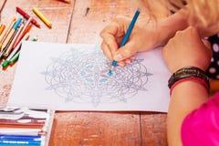 Closeup of woman`s hand drawing mandala Stock Photos