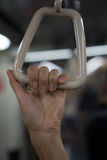 Closeup woman`s hand holding hand holder in the metro. Against blurred lights indoor train background stock images
