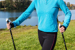 Closeup of woman's hand with nordic walking poles Royalty Free Stock Images