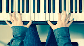 Closeup woman`s hand playing piano Royalty Free Stock Photography