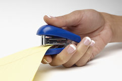 Closeup Of Woman's Hand Stapling Document Stock Image