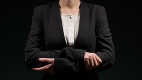 Woman folds her arms over her chest and makes other different gestures