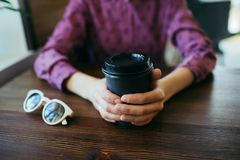 Closeup of woman`s hands with cup of coffee. stock photo
