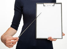 Closeup of woman's hands holding clipboard Royalty Free Stock Photo