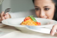 Closeup of woman's hands holding fork and knife. Stock Photos