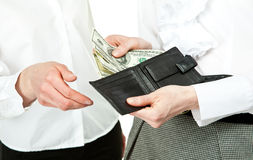 Closeup of woman's hands paying money Stock Images