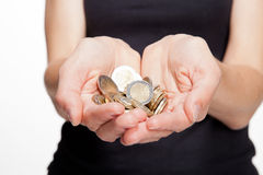 Closeup of woman's hands showing coins Royalty Free Stock Image