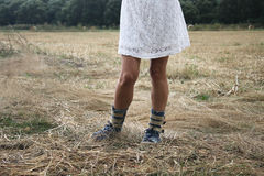 Closeup woman`s legs. Outdoor picture of woman`s legs on a rural path Royalty Free Stock Images