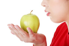 Closeup woman's mouth and apple. Stock Photos