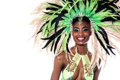 Closeup of woman samba dancer. Cheerful samba dancer posing to camera over white stock image