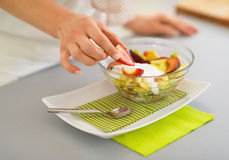 Closeup on woman serving fresh fruit salad Royalty Free Stock Photos