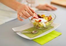 Closeup on woman serving fresh fruit salad Royalty Free Stock Photos