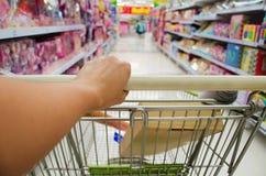 Closeup of woman with shopping cart Stock Image
