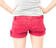 Closeup woman show red shorts and arms akimbo with white backgro. Und Stock Images