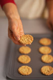 Closeup on woman showing christmas cookie from pan Royalty Free Stock Photo