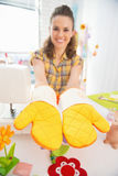 Closeup on woman showing easter pot holder mitts Royalty Free Stock Images