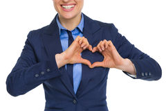 Closeup on woman showing heart with fingers Stock Photo