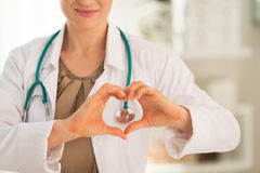 Closeup on woman showing heart shape gesture Stock Photos