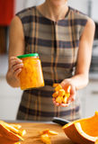 Closeup on woman showing jar of pickled pumpkin Stock Photography