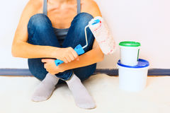 Closeup of woman sitting with paint Royalty Free Stock Images