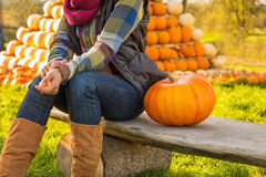 Closeup on woman sitting with pumpkin Stock Images
