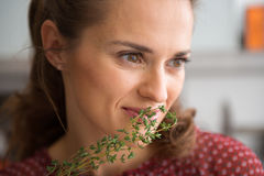 Closeup of woman smelling fresh thyme Royalty Free Stock Photography