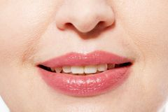 Closeup of woman smile with prefect white teeth isolated on white background. Collagen and face injections. Lips. Mock up. Cropped. Image Stock Photo