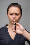 Closeup of woman smoking cigarette and a hand with Stock Image
