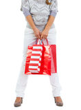 Closeup on woman standing with red shopping bags Stock Photo
