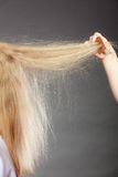 Closeup of woman with static blonde hair. Royalty Free Stock Image