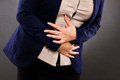 Closeup of woman with stomach issues Royalty Free Stock Image