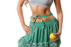 Closeup of woman stomach with measuring tape Stock Image