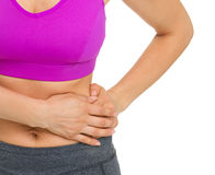 Closeup on woman with stomach pain Stock Images
