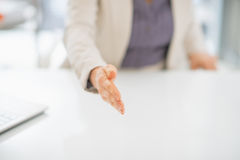 Closeup on woman stretching hand for handshake Royalty Free Stock Photos