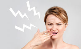 Closeup of woman suffering from toothache. Tooth pain and dentistry, woman feeling strong toothache royalty free stock images