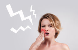 Closeup of woman suffering from toothache. Tooth pain and dentistry, woman feeling strong toothache royalty free stock image
