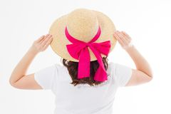Closeup of woman in summer beach hat back view isolated on white background. Template t shirt rear view. Vacation and fun holidays. Concept. Copy space royalty free stock image
