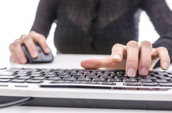 Closeup of a woman surfing the internet. Over white background Royalty Free Stock Image