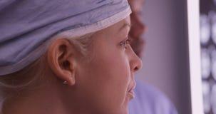 Closeup of woman surgeon looking at xrays Stock Images